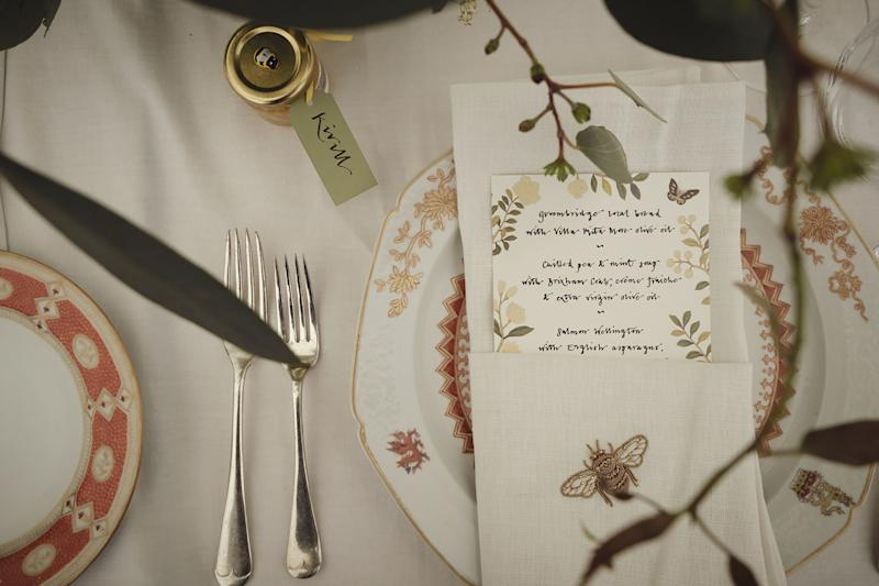 """Guests dined off de Gournay hand-carved porcelain, and the design on the menus again referenced the """"Temple Newsam"""" chinoiserie: my favorite de Gournay wallpaper. Each antique linen napkin was hand-embroidered by de Gournay artists with a bumblebee motif in threaded gold."""