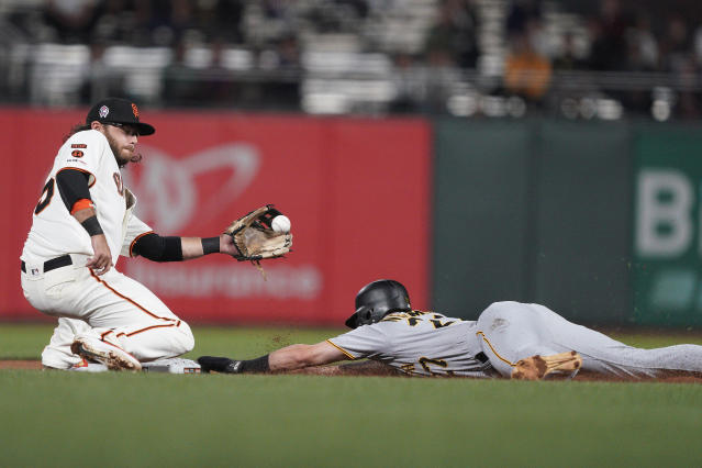 Pittsburgh Pirates' Kevin Newman, right, slides safely into second with a stolen base, next to San Francisco Giants shortstop Brandon Crawford during the fifth inning of a baseball game Wednesday, Sept. 11, 2019, in San Francisco. (AP Photo/Tony Avelar)