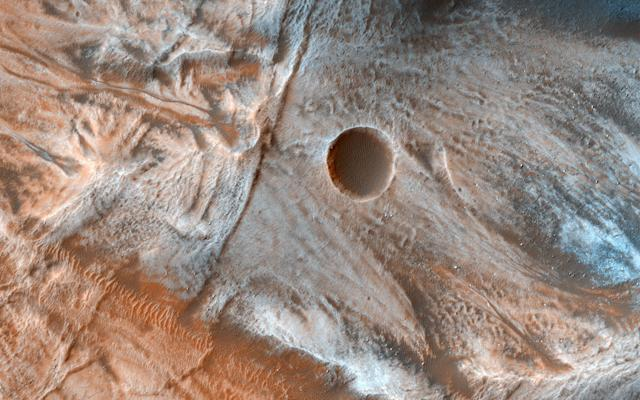 <p>A view of the surface of Mars released by NASA on March 7, 2017, shows viscous, lobate flow features commonly found at the bases of slopes in the mid-latitudes of Mars, and are often associated with gullies. These are bound by ridges that resemble terrestrial moraines, suggesting that these deposits are ice-rich, or may have been ice-rich in the past. (Photo: NASA/JPL-Caltech/Univ. of Arizona/Handout via Reuters) </p>