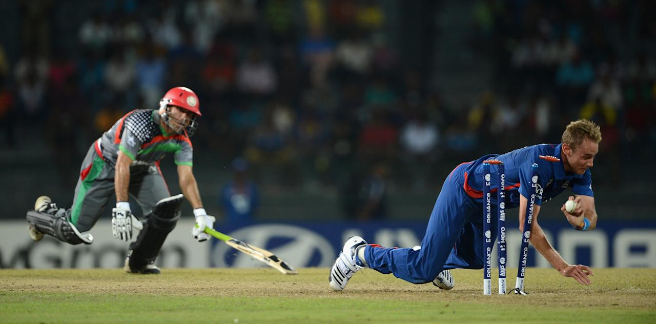 COLOMBO, SRI LANKA - SEPTEMBER 21:  England captain Stuart Broad runs out Karim Sadiq of Afghanistan during the ICC World Twenty20 2012 Group A match between England and Afghanistan at R. Premadasa Stadium on September 21, 2012 in Colombo, Sri Lanka.  (Photo by Gareth Copley/Getty Images)