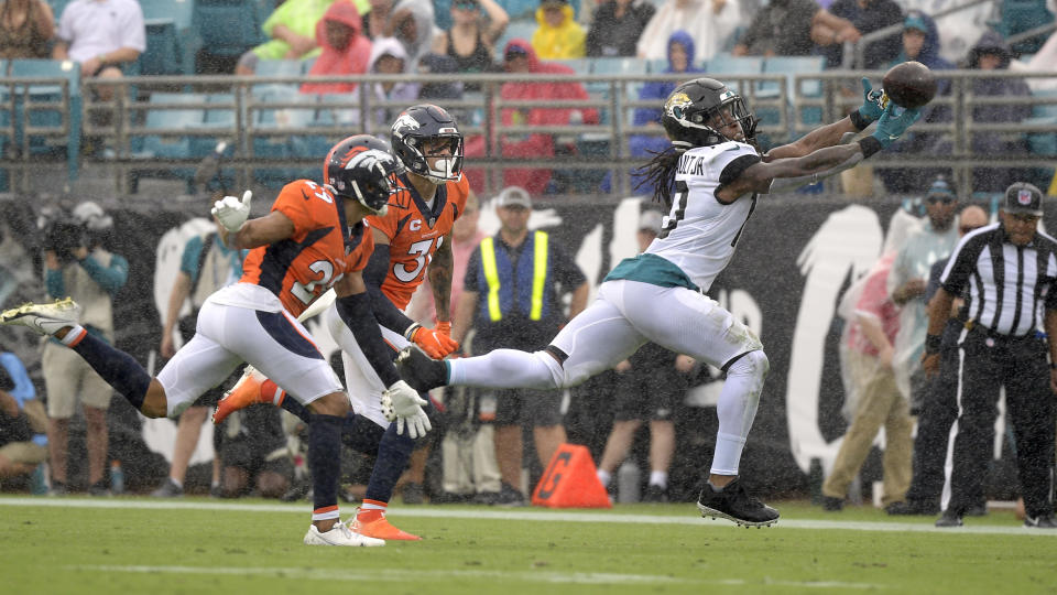 Jacksonville Jaguars wide receiver Laviska Shenault Jr., right, can't make a catch in front of Denver Broncos cornerback Bryce Callahan, left, and safety Justin Simmons, center, during the first half of an NFL football game, Sunday, Sept. 19, 2021, in Jacksonville, Fla. (AP Photo/Phelan M. Ebenhack)