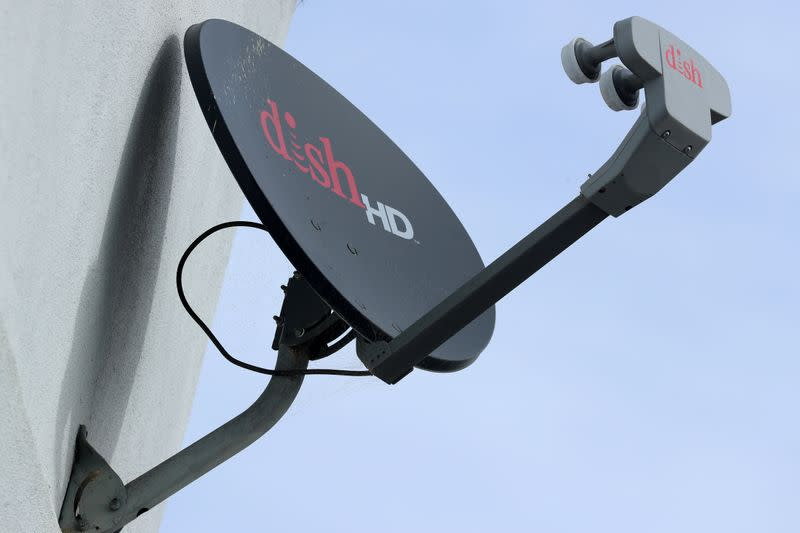 FILE PHOTO: A Dish Network satellite dish is shown on a residential home in Encinitas, California