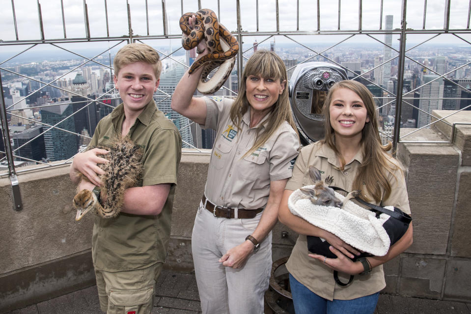 "Robert, from left, Terri and Bindi Irwin visit the 86th floor observation deck at the Empire State Building to promote their new Animal Planet television show ""Crikey! It's The Irwins"" on Thursday, Sept. 20, 2018, in New York."