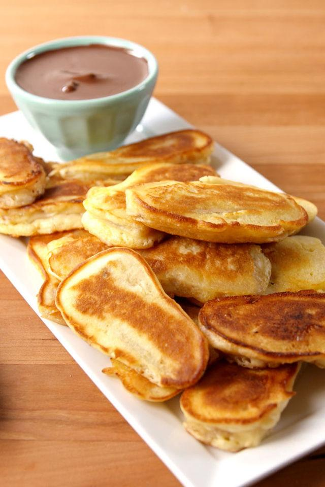 "<p><span>Makin' banana pancakes...♫</span></p><p>Get the recipe from <a rel=""nofollow"" href=""http://www.delish.com/cooking/recipe-ideas/recipes/a51901/banana-pancake-dippers-recipe/"">Delish</a>.</p>"
