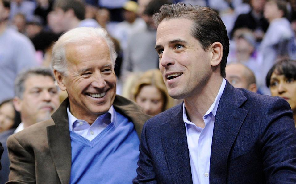Hunter Biden with his father Joe, then Vice-President, in 2010 - AP Photo/Nick Wass