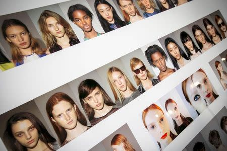 A style board with photos of the models is seen backstage at the Spring/Summer 2015 Richard Chai collection during New York Fashion Week September 4, 2014. REUTERS/Brendan McDermid