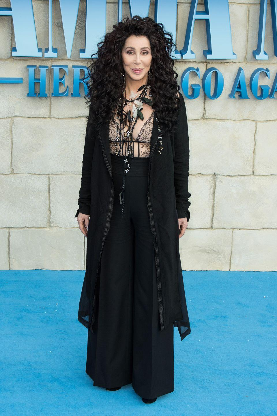 <p>At the premiere for Mamma Mia 2: Here We Go Again in a sheer lace bodysuit, wide-leg pants, and feathered necklaces. </p>