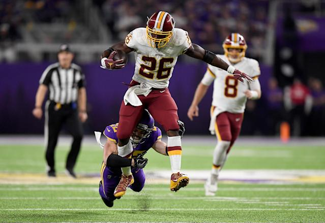 MINNEAPOLIS, MINNESOTA - OCTOBER 24: Running back Adrian Peterson #26 of the Washington Redskins is tackled by Harrison Smith #22 of the Minnesota Vikings during the game at U.S. Bank Stadium on October 24, 2019 in Minneapolis, Minnesota. (Photo by Hannah Foslien/Getty Images)