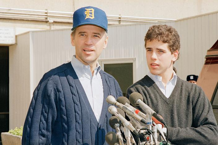 Then-Sen. Joseph Biden, D-Del., wearing a University of Delaware baseball cap, leaves Walter Reed Army Hospital accompanied by his son Hunter Biden, on March 24, 1988, in Washington, D.C. Biden had been hospitalized to receive an of a small umbrella-like filter in a vein to prevent blood clots from reaching his lungs.