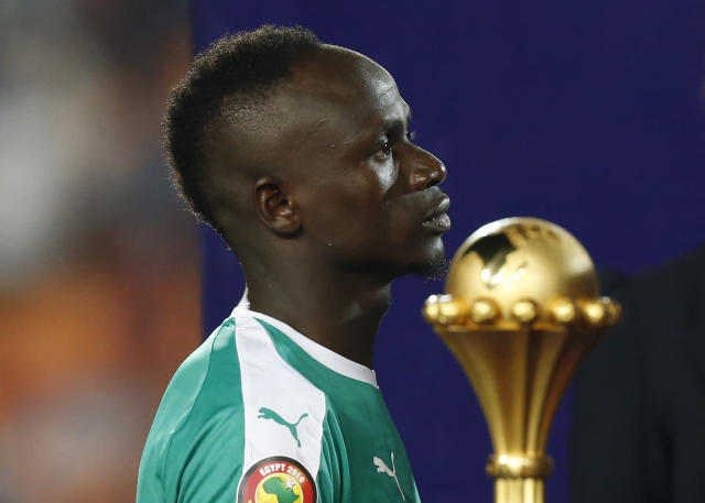 Senegal's Sadio Mane walks past the Cup after the African Cup of Nations final soccer match between Algeria and Senegal in Cairo International stadium in Cairo, Egypt, Friday, July 19, 2019. Algeria won 1-0. (AP Photo/Ariel Schalit)