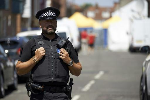 A police officer stands guard at a cordon near Rollestone Street in Salisbury southern EnglandMore