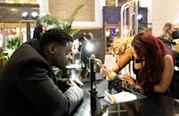 <p>Daniel Kaluuya watches closely as his name is engraved on his Best Supporting Actor statuette at Union Station on Sunday night. </p>