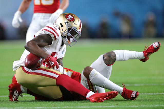 MIAMI, FLORIDA - FEBRUARY 02: Richie James #13 of the San Francisco 49ers is tackled against the Kansas City Chiefs in Super Bowl LIV at Hard Rock Stadium on February 02, 2020 in Miami, Florida. (Photo by Jamie Squire/Getty Images)