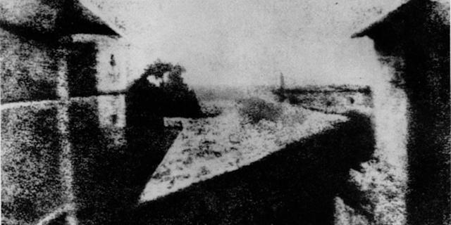 This is the FIRST photograph ever taken, or the earliest known surviving photograph made in a camera, was taken by Joseph Nicéphore Niépce, circa 1826 or 1827. The image shows a view from an upstairs window at Niépce's estate, Le Gras, in the Burgundy region of France. (Photo by Apic/Getty Images)