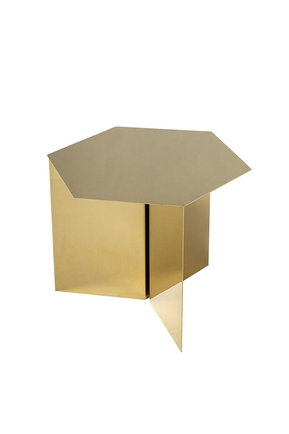 """<p><strong>A side of brass</strong></p><p>Side tables don't come any more statement than the Hay slit brass table. Inspired by origami, its perfect geometry is sure to make your home look sharp.</p><p>£359, <a href=""""https://www.amara.com/products/slit-table-hexagon-brass"""" rel=""""nofollow noopener"""" target=""""_blank"""" data-ylk=""""slk:amara.com"""" class=""""link rapid-noclick-resp"""">amara.com</a></p>"""