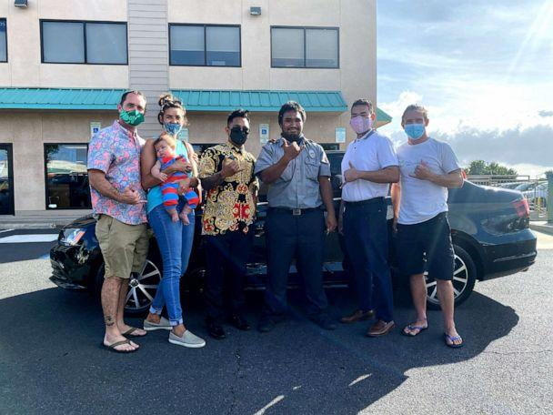 PHOTO: Aina Townsend, 22, poses for a picture with Chloe and Gray Marino, Greg Gaudet and other KarMART employees after receiving his new car. (Joshua Kong/KarMART)
