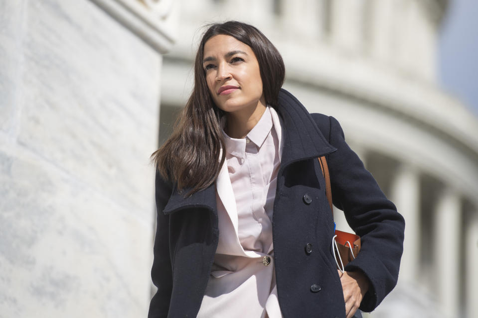 Alexandria Ocasio-Cortez talks about fitting into her professional environment as a working-class woman. (Photo: Getty Images)