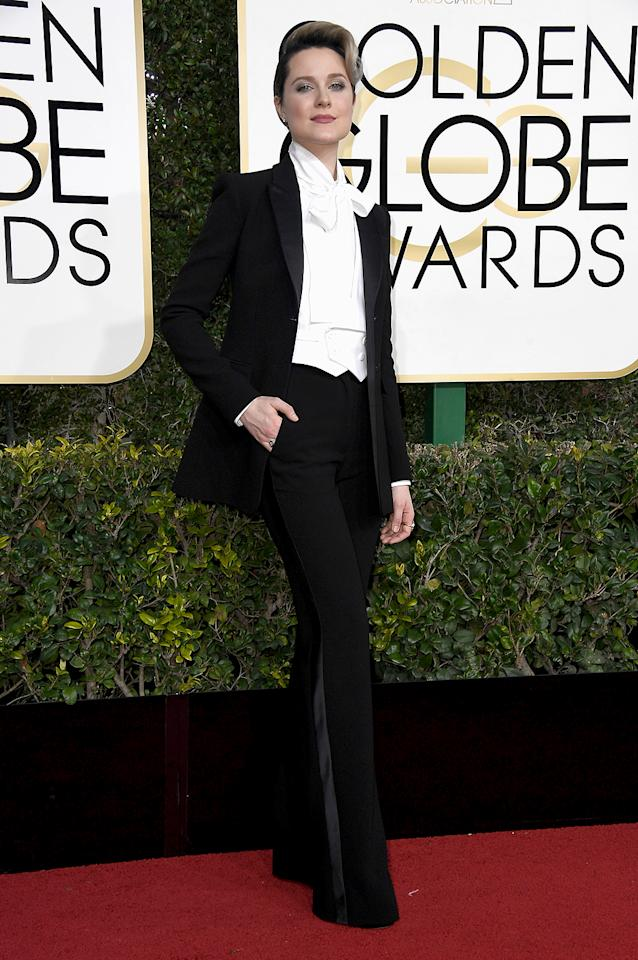 """<p>Evan Rachel Wood turned heads by stepping onto the carpet in a dramatic black suit, and with a feminist message. The <i>Westworld</i> star's ensemble wasn't off the rails, but it was a far cry from the usual onslaught of diaphanous gowns and sparkles. """"This is a custom suit by Altuzarra. This is my third nomination. I've been to the Globes six times, and I've worn a dress every time,"""" she explained of her look. """"I love dresses. I'm not trying to protest dresses. But I wanted to make sure that young girls and women know that they aren't a requirement. And you don't have to wear one if you don't want to. And to just be yourself because your worth is more than that. So, I said, this year I'm going homage to Marlene Dietrich and <i>Victor/Victoria</i> and David Bowie, because it's his birthday."""" You go, girl. (Photo: Frazer Harrison/Getty Images) </p>"""