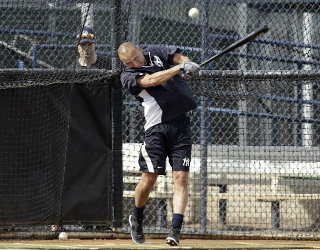 New York Yankees shortstop Derek Jeter hits the baseball during practice at the Yankees' minor league facility Wednesday, Feb. 12, 2014, in Tampa, Fla. Jeter says he will retire after this season. Jeter posted a long letter on his Facebook account Wednesday, Feb. 12, 2014, saying the 2014 will be his last year playing professional baseball.(AP Photo/Chris O'Meara)