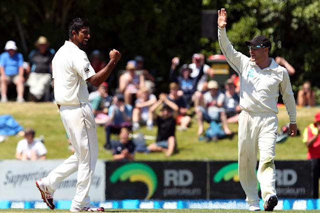 DUNEDIN, NEW ZEALAND - DECEMBER 05: Ish Sodhi of New Zealand celebrates taking the wicket of Shannon Gabriel during day three of the first test match between New Zealand and the West Indies at University Oval on December 5, 2013 in Dunedin, New Zealand. (Photo by Rob Jefferies/Getty Images)