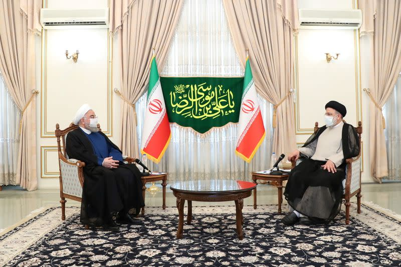 Iran's outgoing President Rouhani meets with the Iran's President-elect Raisi in Tehran
