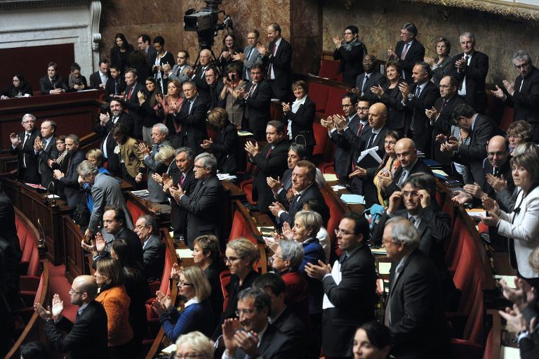 Some left-wing members of Parliament applaud after French lawmakers voted in favour of recognising Palestine as a state on December 2, 2014, at the French National Assembly in Paris