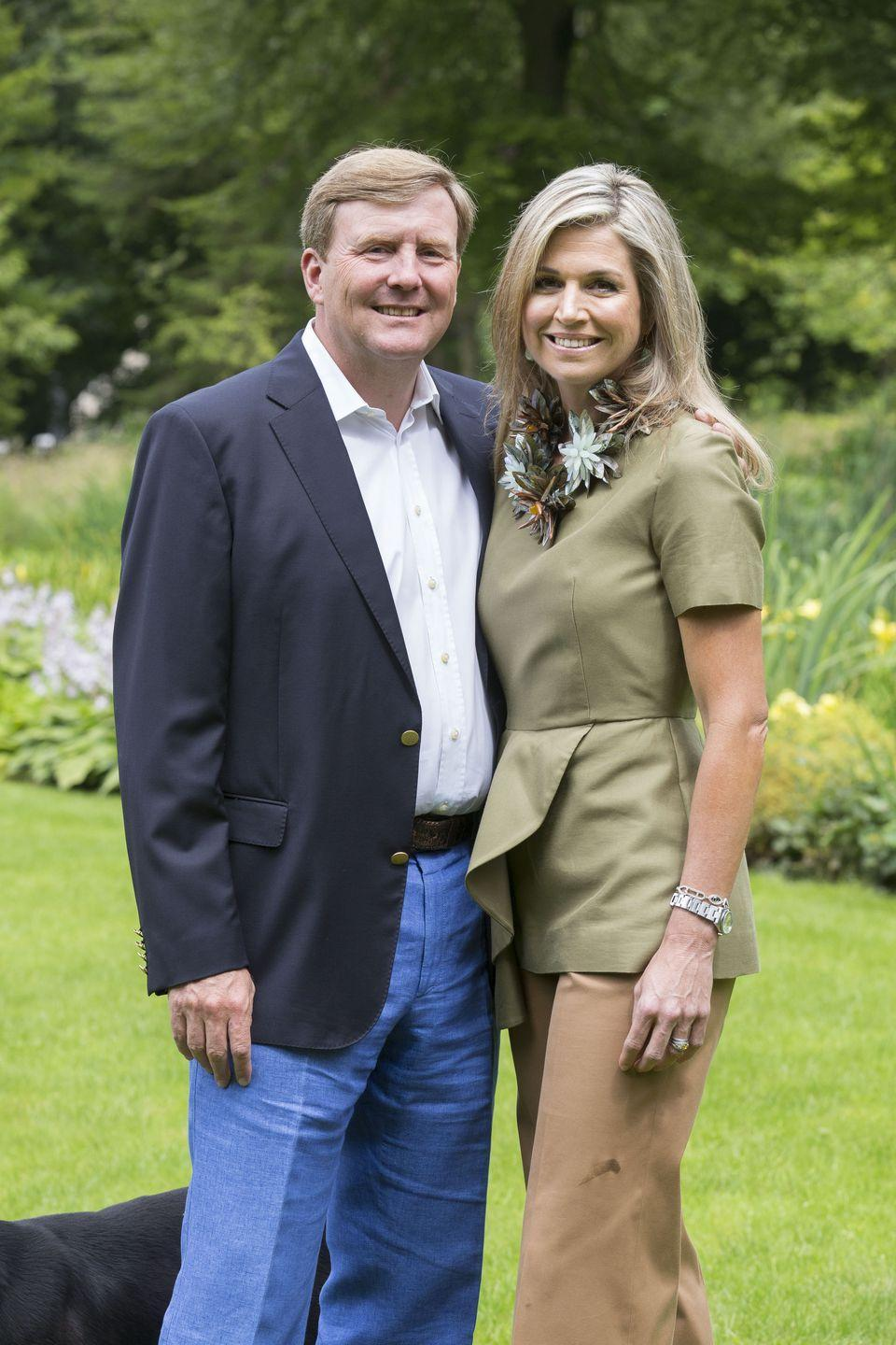 <p>She embraces both bright color and standby neutrals, as evidenced by this portrait of her and King Willem-Alexander at their home. And like the Duchess of Cambridge, she appreciates fast fashion—her blouse is from COS.</p>