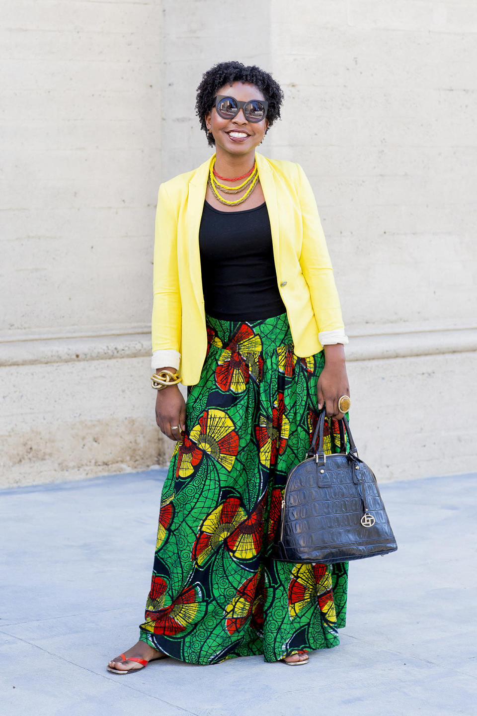 """<p><b>Yahoo Style: You look amazing!<br>Laine Sims: </b>A few African friends brought me back this skirt from Kenya. And the necklaces are from Nigeria. The glasses are from <a href=""""http://zoesvintique.com/"""" rel=""""nofollow noopener"""" target=""""_blank"""" data-ylk=""""slk:Zoe's Vintique"""" class=""""link rapid-noclick-resp"""">Zoe's Vintique</a> in South L.A.</p><p><b>Are you the fiercest dresser here?<br></b>Umm, well, humility is a grand thing! Let's just say, I like to represent myself well, and I do get compliments, so I guess I'm doing something right. I've been coming to this church for eight years.</p><p><b>What does it mean to """"love on?""""<br></b>Without being too Christian-y, the message of Jesus is to love people, whether that's helping them or connecting them to a helping hand. It's not complex.</p><p><b>How does that play out in your daily life?<br></b>I'm a very social person, relational. I've been at a new job now probably one and a half months, and I've been able to be a light when co-workers are discouraged, and hopefully it makes their day better.</p><p><b>Do you talk to them about Jesus?<br></b>No. Of course, church comes up in conversation because it's a big part of my life. But mostly I try to be an example of who God is. They know there's something different about me, and when they get to know me, they're like, """"Oh, that's it!""""</p><p><b>Would this church get into social-justice issues like #BlackLivesMatter?<br></b>We don't really get too involved in social justice. All we do is love on people. We have an organization called <a href=""""http://generositywater.com/"""" rel=""""nofollow noopener"""" target=""""_blank"""" data-ylk=""""slk:Generosity Water"""" class=""""link rapid-noclick-resp"""">Generosity Water</a> that raised money to build over 500 water wells in countries in need. We're also building a baseball field in Haiti.</p>"""