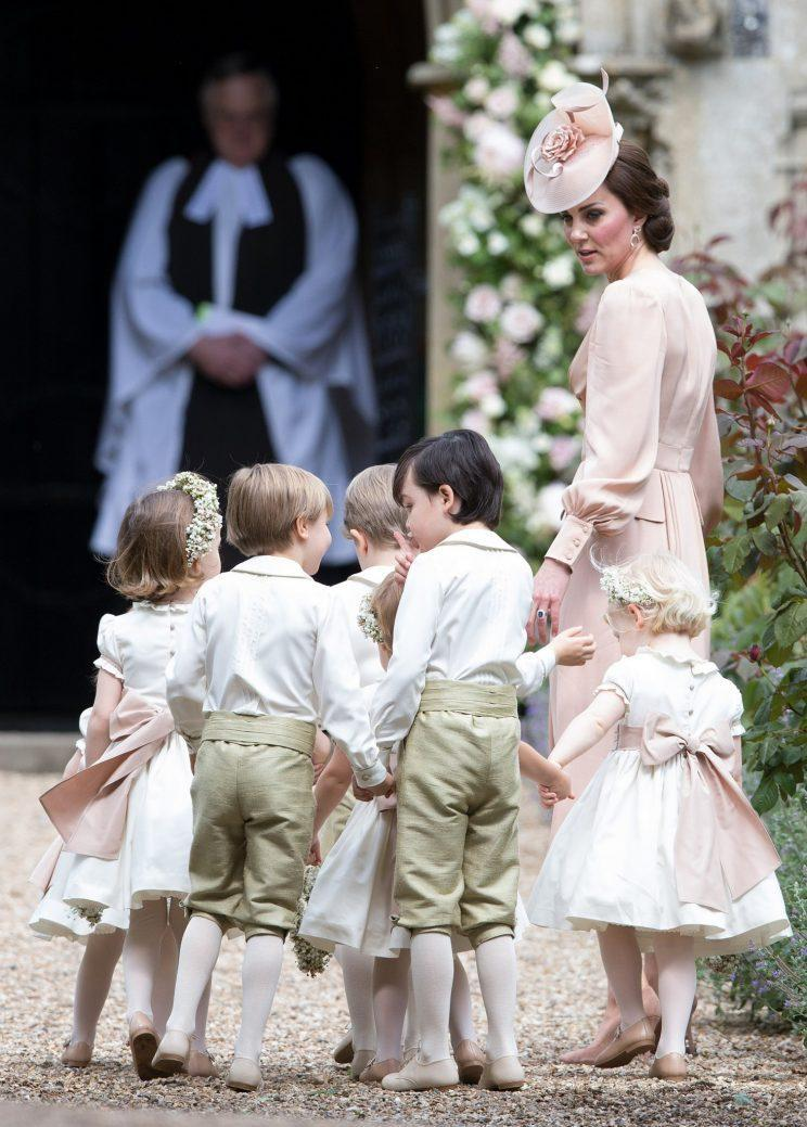 The Duchess shepherded the children into the church [Photo: PA]