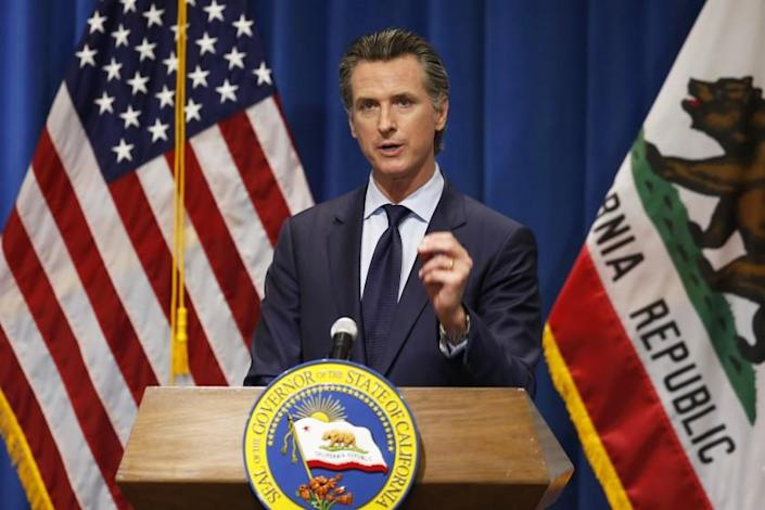 FILE— In this May 14, 2020 file photo California Gov. Gavin Newsom discusses his revised 2020-2021 state budget during a news conference in Sacramento, Calif. Newsom will unveil his 2021-2022 proposed state budget Friday, Jan. 8. (AP Photo/Rich Pedroncelli, File, Pool)