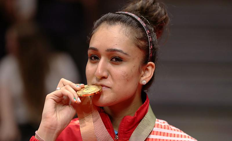 Table Tennis - Gold Coast 2018 Commonwealth Games - Women's Singles Medal Ceremony - Oxenford Studios - Gold Coast, Australia - April 14, 2018 - Gold medalist Manika Batra of India poses with medal. REUTERS/Jeremy Lee - UP1EE4E0RJIGM