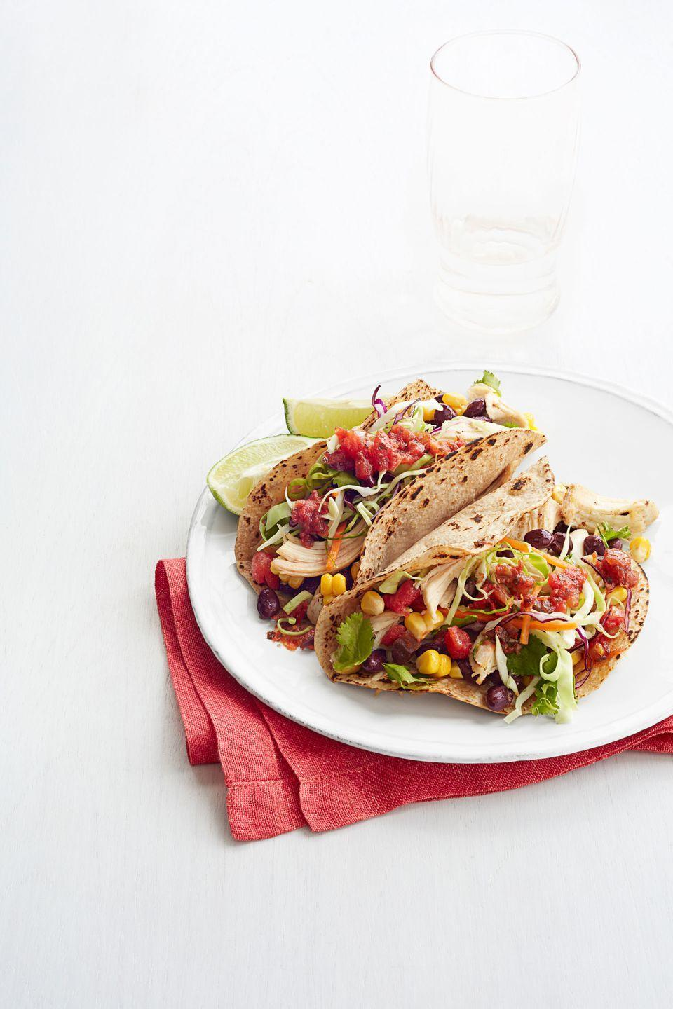 "<p>Forget Taco Tuesday! Serve up these quickie, chicken tacos any night of the week. </p><p><a href=""https://www.goodhousekeeping.com/food-recipes/a14538/super-speedy-chicken-tacos-recipe-ghk0214/"" rel=""nofollow noopener"" target=""_blank"" data-ylk=""slk:Get the recipe for Super-Speedy Chicken Tacos »"" class=""link rapid-noclick-resp""><em>Get the recipe for Super-Speedy Chicken Tacos »</em></a> </p>"