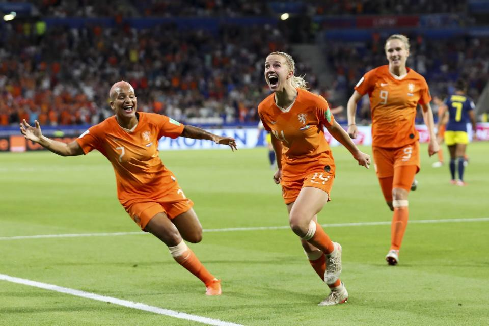 Netherlands' Jackie Groenen, center, celebrates after scoring during the Women's World Cup semifinal soccer match between the Netherlands and Sweden, at the Stade de Lyon outside Lyon, France, Wednesday, July 3, 2019. (AP Photo/Francisco Seco)