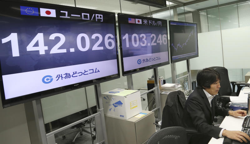 A money trader works under a screen indicating the U.S. dollar and euro are traded higher against the Japanese yen at a foreign exchange dealing company in Tokyo, Tuesday, Dec. 10, 2013. Asian stock markets were muted Tuesday amid some profit taking and ahead of Chinese data on industrial production and retail sales. Japan's Nikkei 225 fell 0.4 percent to 15,592.67. (AP Photo/Koji Sasahara)