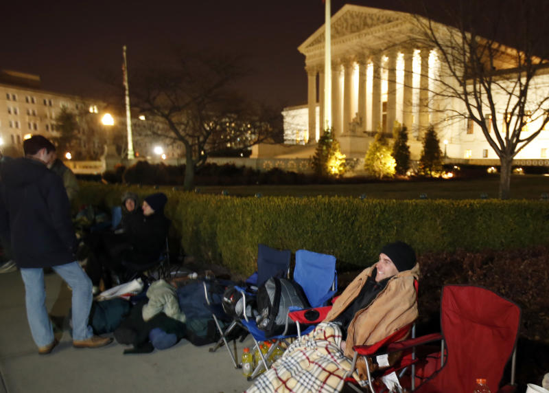 Jerome Weaver, from Vineland, N.J., waits in line in front of the Supreme Court, Monday, March 24, 2014, in Washington. The Supreme Court is weighing whether corporations have religious rights that exempt them from part of the new health care law that requires coverage of birth control for employees at no extra charge. (AP Photo/Alex Brandon)