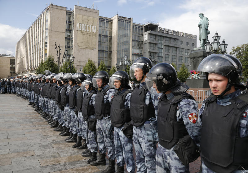 Police block a square during an unsanctioned rally in the center of Moscow, Russia, Saturday, Aug. 3, 2019. Moscow police on Saturday detained nearly 90 people protesting the exclusion of some independent and opposition candidates from the city council ballot, a monitoring group said, a week after arresting nearly 1,400 at a similar protest. (AP Photo/ Alexander Zemlianichenko)