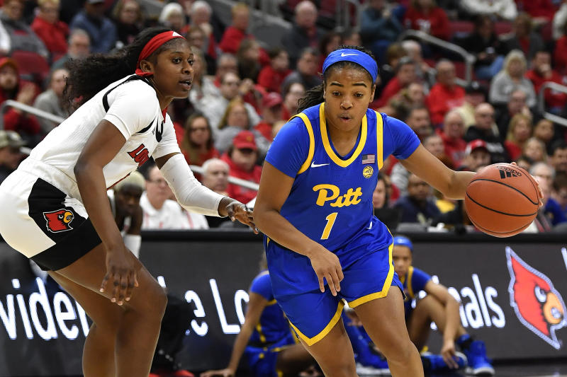 Pittsburgh guard Dayshanette Harris (1) drives around Louisville guard Elizabeth Balogun (4) during the first half of an NCAA college basketball game in Louisville, Ky., Sunday, Jan. 26, 2020. (AP Photo/Timothy D. Easley)