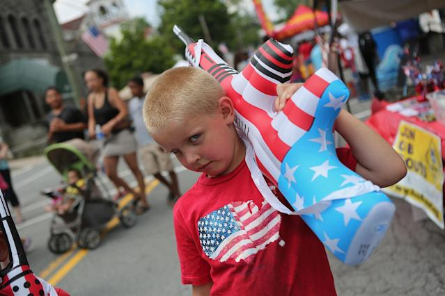 <p>Alexander Depuy, 5, holds an inflatable toy gun at the 19th annual Liberty Festival on July 4, 2012 in Liberty, N.Y. Communities around the country celebrated Independence Day with parades, summer activites and shows of patriotism. (Photo: John Moore/Getty Images) </p>
