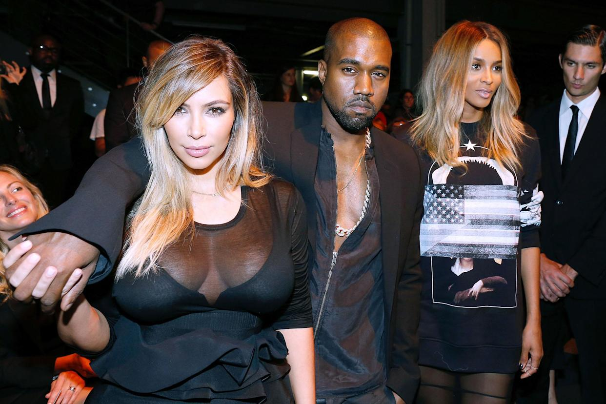 PARIS, FRANCE - SEPTEMBER 29:  Kim Kardashian, Kanye West and singer Ciara attend Givenchy show as part of the Paris Fashion Week Womenswear  Spring/Summer 2014, held at 'la Halle Freyssinet' on September 29, 2013 in Paris, France.  (Photo by Bertrand Rindoff Petroff/Getty Images)