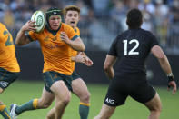 Australia's Michael Hooper catches the ball as he runs at New Zealand's David Havili during the Rugby Championship game between the All Blacks and the Wallabies in Perth, Australia, Sunday, Sept. 5, 2021. (AP Photo/Gary Day)
