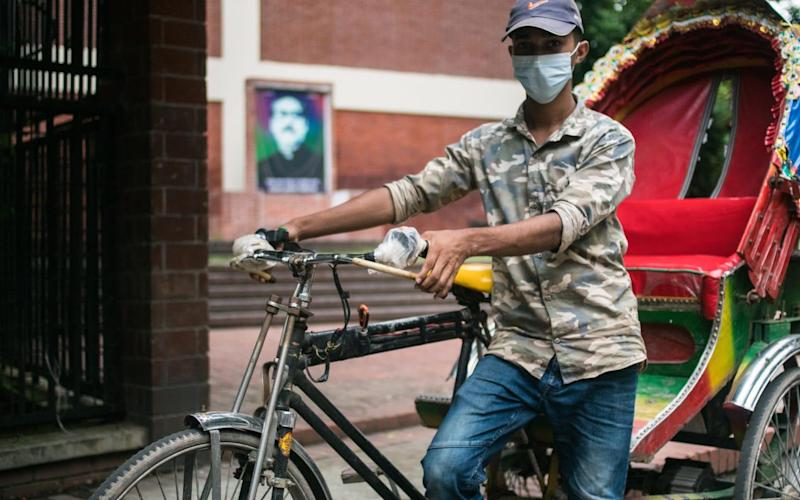 Mohammed Shanto used to have relatively well-paying job as a store manager in a garment wholesalers, allowing him to save money to go college. The pandemic meant he lost his job, however, and was forced to take up rickshaw pulling - Tousif Farhad