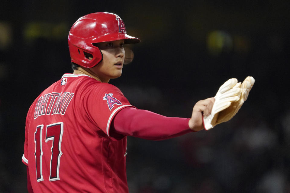 Los Angeles Angels designated hitter Shohei Ohtani gestures to the first base umpire after walking during the fifth inning of a baseball game against the Seattle Mariners Saturday, Sept. 25, 2021, in Anaheim, Calif. (AP Photo/Mark J. Terrill)