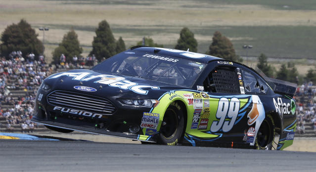 Carl Edwards competes during the NASCAR Sprint Cup Series auto race on Sunday, June 22, 2014, in Sonoma, Calif. (AP Photo/Eric Risberg)