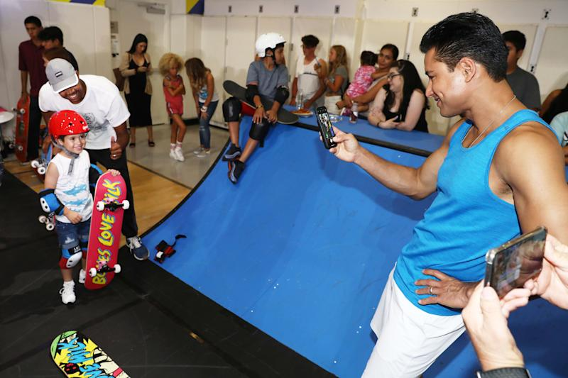 Mario Lopez watches on as son, Nico, gets geared up and ready to shred at the Bones Love Milk Shredquarters in Huntington Beach, Calif., Wednesday, July 24, 2019. The immersive, indoor skatepark experience is part of a week-long program hosted by the California Milk Processor Board dedicated to celebrating skate and California street culture while showcasing the real benefits of milk as nature's energy drink. (Photo by Matt Sayles/Invision for CMPB/AP Images)
