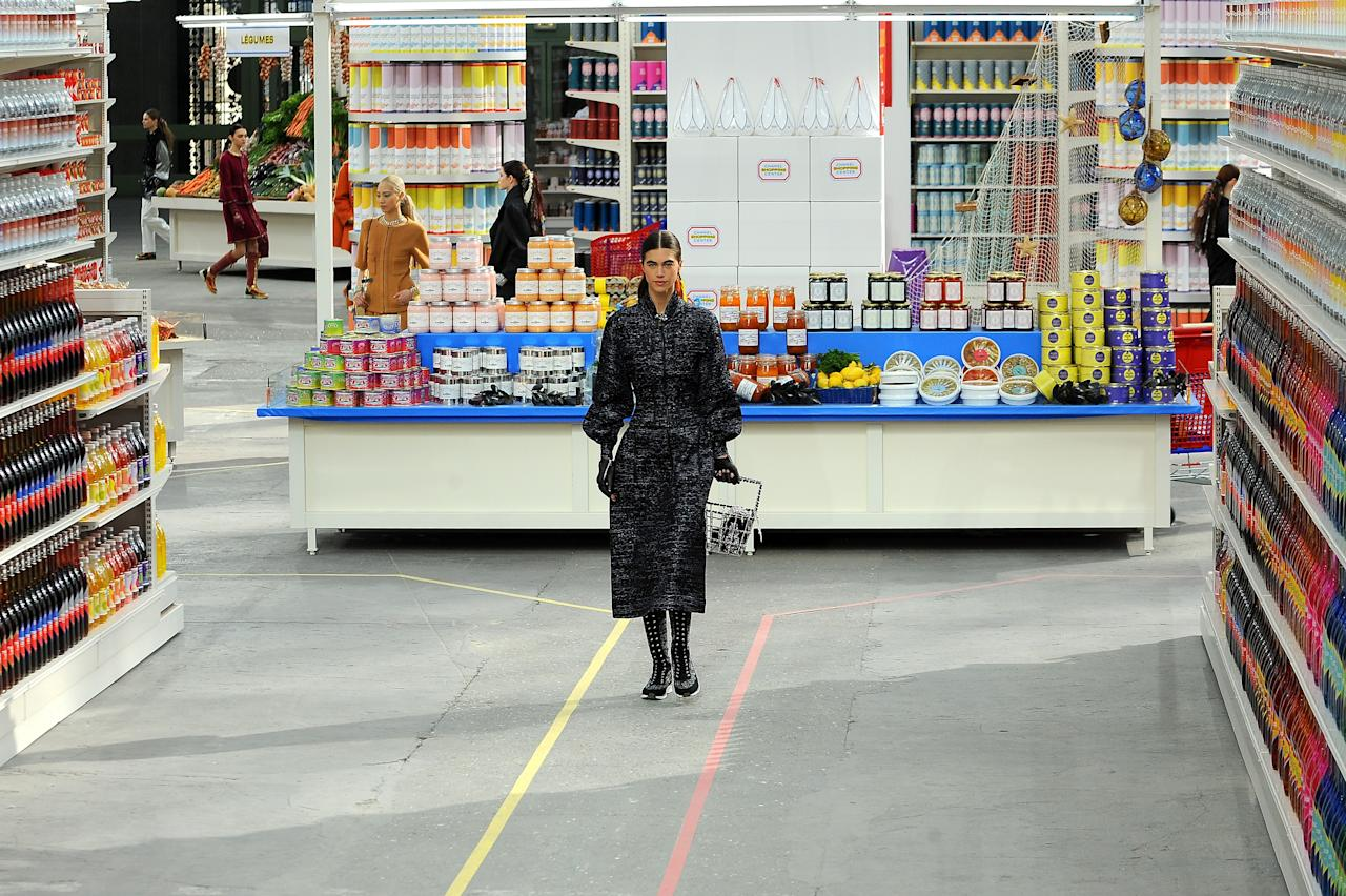 <p>The opening of the Chanel supermarket was the day the fashion industry went into chaos. Esteemed editors fought for Chanel-branded goods including cereal, crisps and chainsaws in the aisles (and were swiftly told to replace everything on the shelves). Lagerfeld had succeeded in causing a conversation around fast fashion.<br /><i>[Photo: Getty]</i> </p>