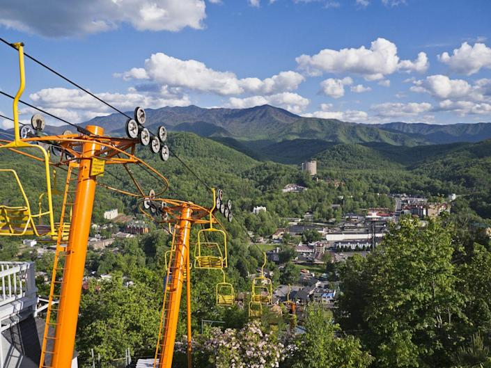 """<p>A small mountain town in eastern Tennessee, Gatlinburg is super scenic and perfect for nature-lovers. It's located right alongside the Great Smoky Mountains National Park, making it the perfect stop before or after some hiking. Be sure to check out the <a href=""""https://www.gatlinburgspaceneedle.com/"""" rel=""""nofollow noopener"""" target=""""_blank"""" data-ylk=""""slk:Space Needle observation tower"""" class=""""link rapid-noclick-resp"""">Space Needle observation tower</a> and the <a href=""""https://www.gatlinburgskylift.com/"""" rel=""""nofollow noopener"""" target=""""_blank"""" data-ylk=""""slk:Sky Lift"""" class=""""link rapid-noclick-resp"""">Sky Lift</a>, an aerial cable car, for some gorgeous views. </p>"""