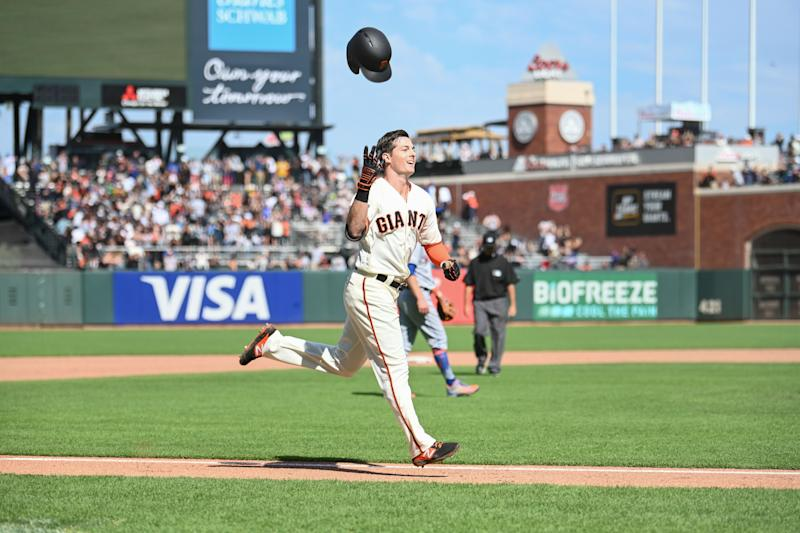 SAN FRANCISCO, CA - JULY 21: San Francisco Giants Outfield Mike Yastrzemski (5) tosses his helmet as he rounds the bases after his walk off solo home run during the MLB game between the New York Mets and the San Francisco Giants on July 21, 2019 at Oracle Park in San Francisco Ca. (Photo by Stephen Hopson/Icon Sportswire via Getty Images)