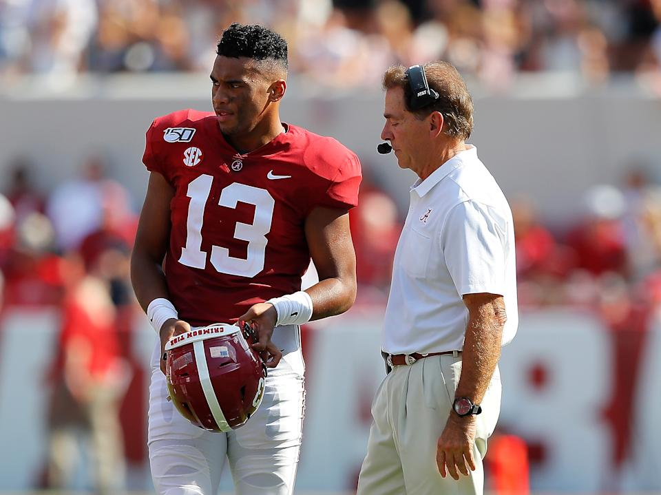 Nick Saban, right, tried his best to get away from the Miami Dolphins once. Might Tua Tagovailoa, left, want to avoid them altogether? (Getty Images)
