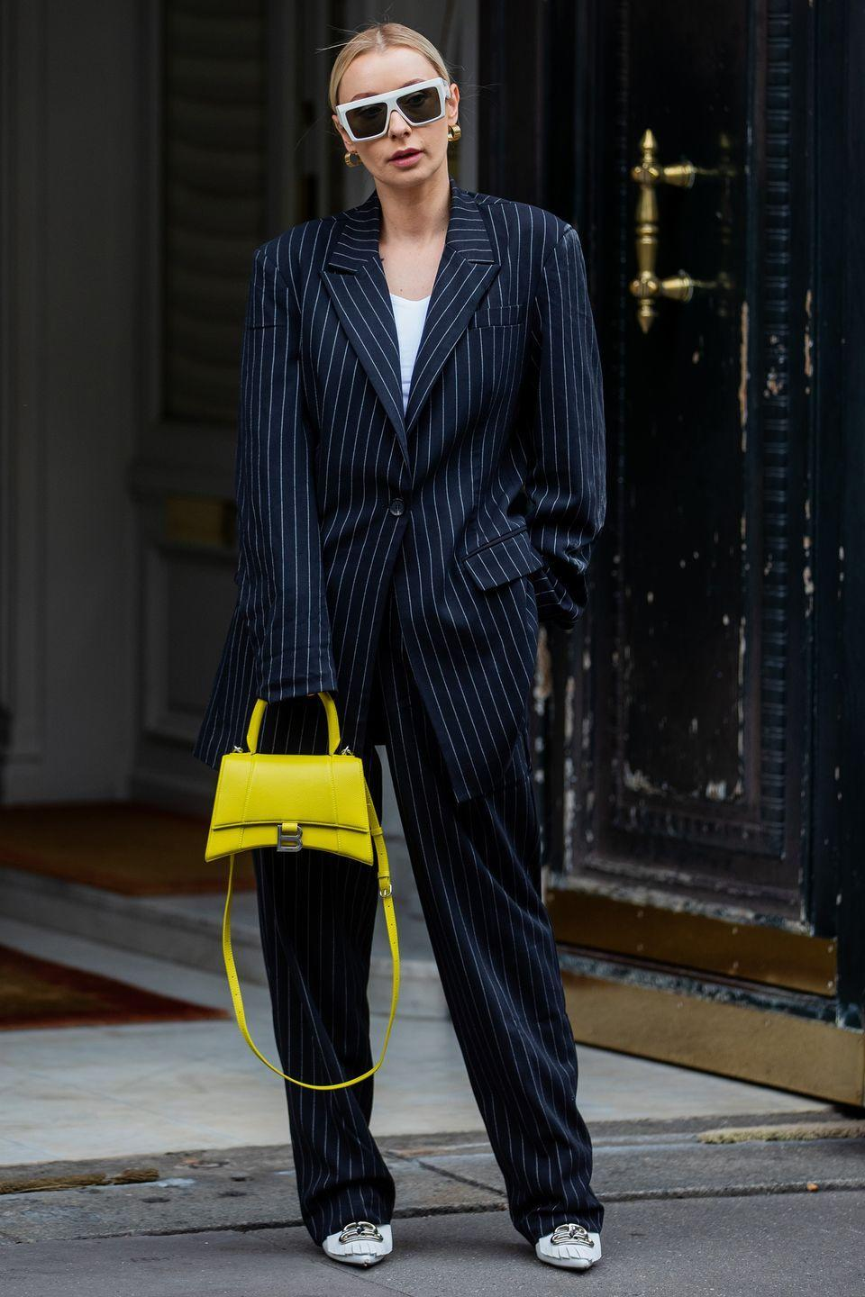 <p>There are few prints more timeless than the pinstripe. Embrace it in an oversized suit like this street styler.</p>
