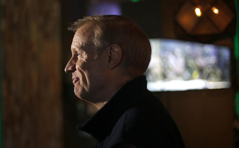 Republican gubernatorial primary candidate Bruce Rauner listens to a reporters' question during a campaign stop Monday, March 17, 2014, in Edwardsville, Ill. Rauner faces State Sen. Bill Brady, State Sen. Kirk Dillard and State Treasurer Dan Rutherford in Tuesday's primary. (AP Photo/Charles Rex Arbogast)